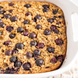 Baking dish with Blueberry Baked Oatmeal topped with fresh blueberries.