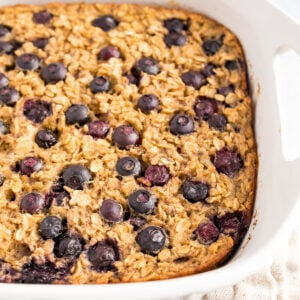 White baking dish with blueberry baked oatmeal.