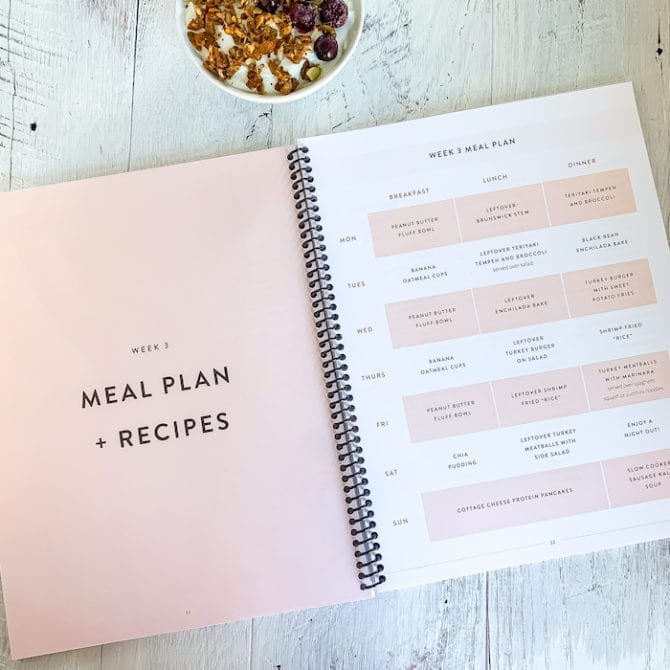 Meal plan spiral bound book, open on a counter.