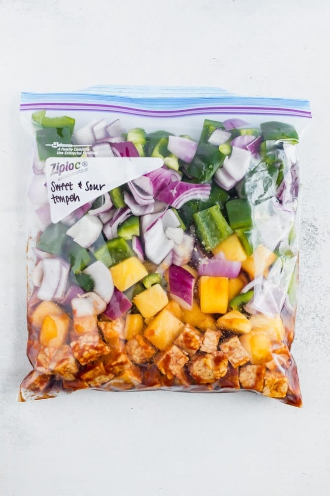 Freezer meal. Sweet and sour tempeh in a freezer bag with pineapple, peppers and onions.