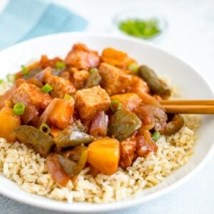 Slow cooker tempeh, onion, pineapple and peppers served over brown rice.