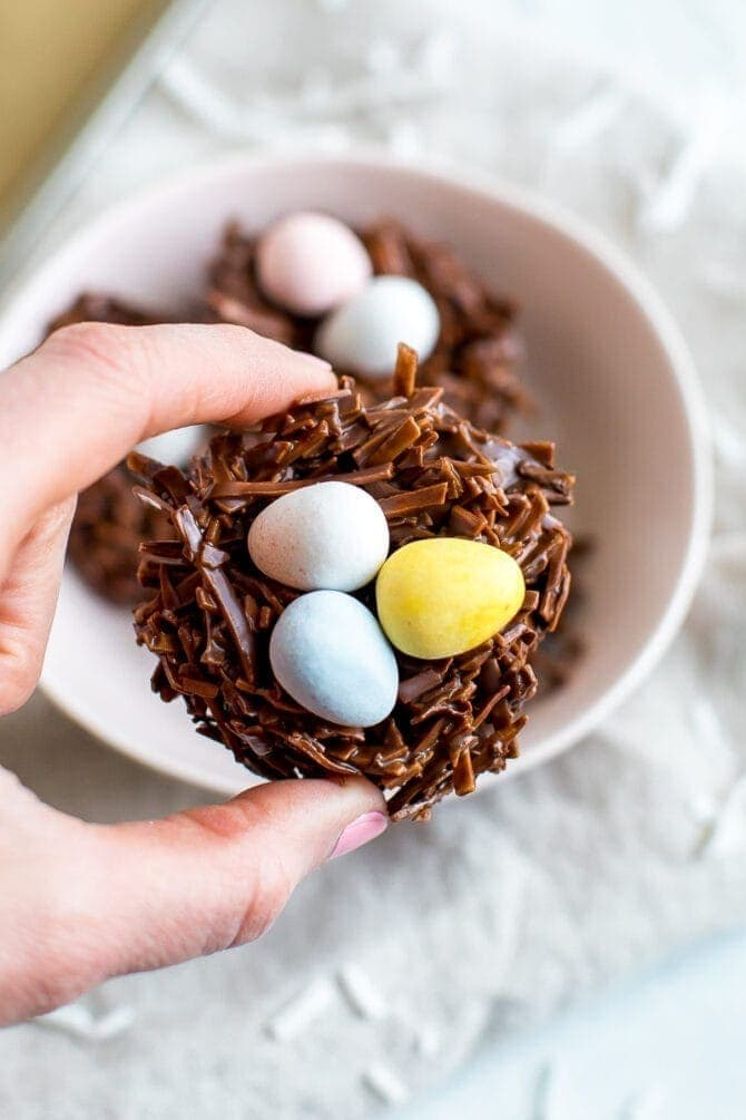 Chocolate coconut flake Easter nest treats with Cadbury eggs in the nest.