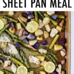 Lemon garlic sheet pan meal with chicken, potatoes and asparagus. Topped with lemon slices.
