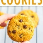Hand holding a coconut flour cookies with chocolate chips.