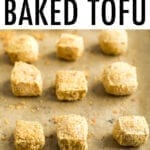 Crispy baked tofu on a sheet pan with parchment paper.