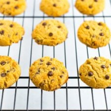 Coconut flour chocolate chip cookies on a cooling rack.