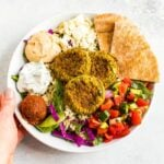 Falafel bowl with baked falafel, hummus, feta, pita, salad and rice.