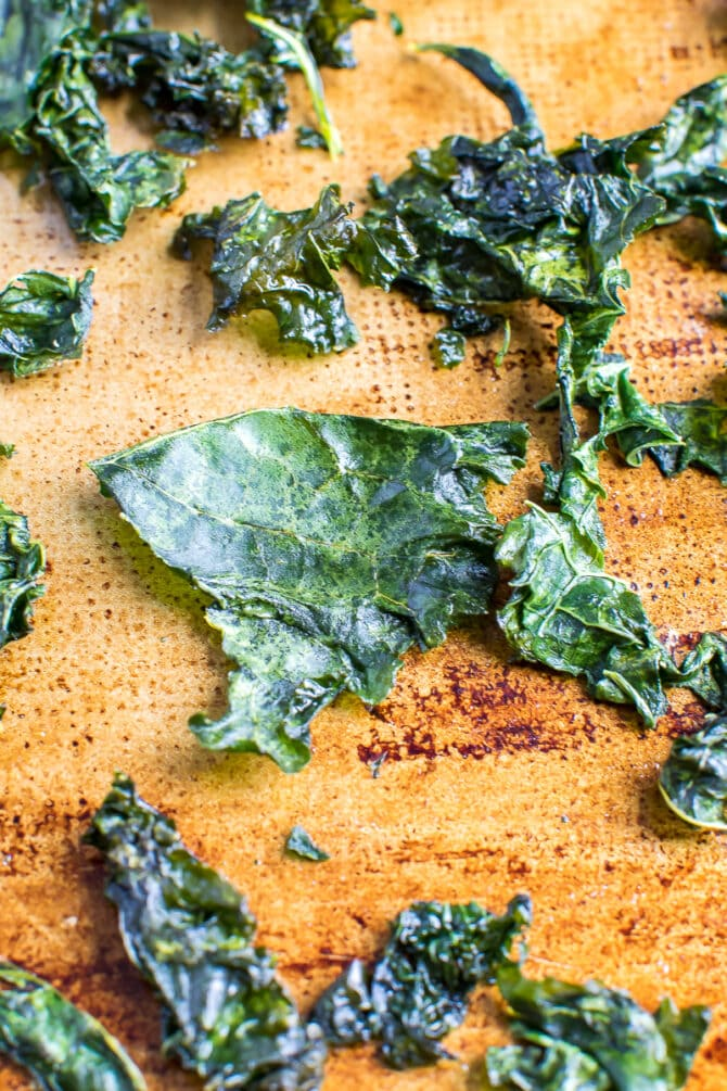 kale chips caked on a baking sheet.