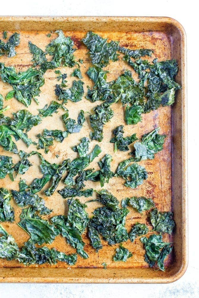 Kale chips baked on a tray.