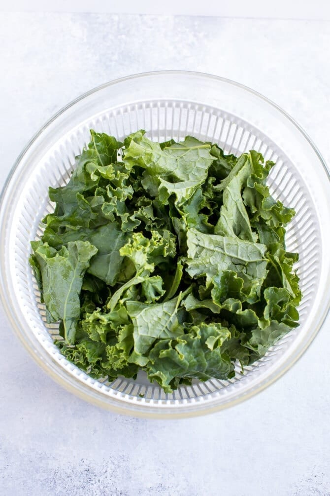 Salad spinner with kale inside.