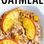 Bowl of peach baked oatmeal topped with almond milk and cinnamon,