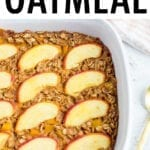 Peach baked oatmeal in a baking dish with peach slices baked on top.