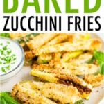 Plate of crispy zucchini fries on a plate with a creamy dip topped with chopped parsley.