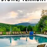 Stowe, Vermont poolside with a view of the mountains.