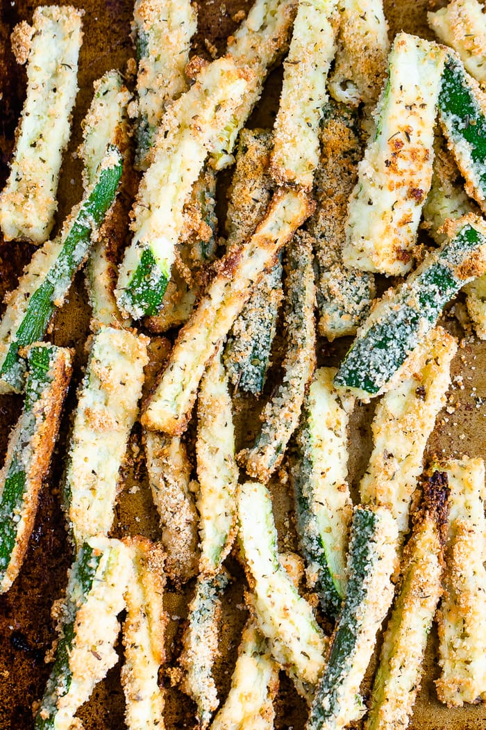 Sheet pan with crispy baked zucchini fries.
