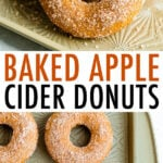 Baked apple cider donuts on a sheet with a glass of cider.