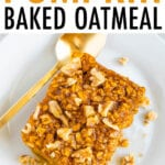 Slice of pumpkin baked oatmeal topped with walnuts and maple syrup. Oatmeal is on a plate with a gold spoon.