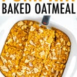 A spatula is lifting a slice of pumpkin baked oatmeal out of a baking dish.