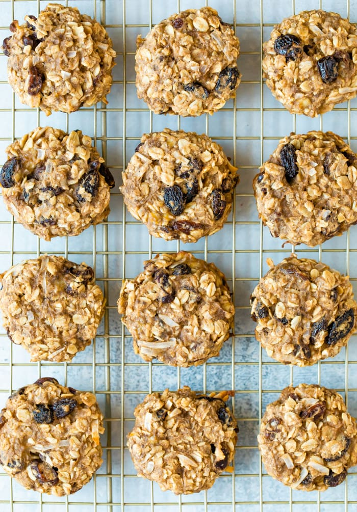 Oatmeal raisin protein cookies on a cooling rack.