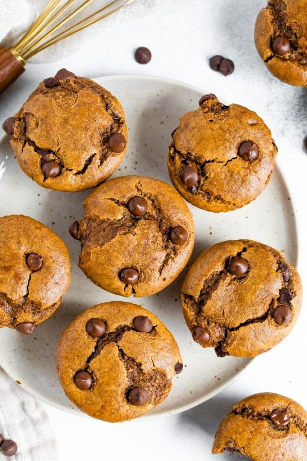 Overhead shot of flourless pumpkin muffins on a white plate.