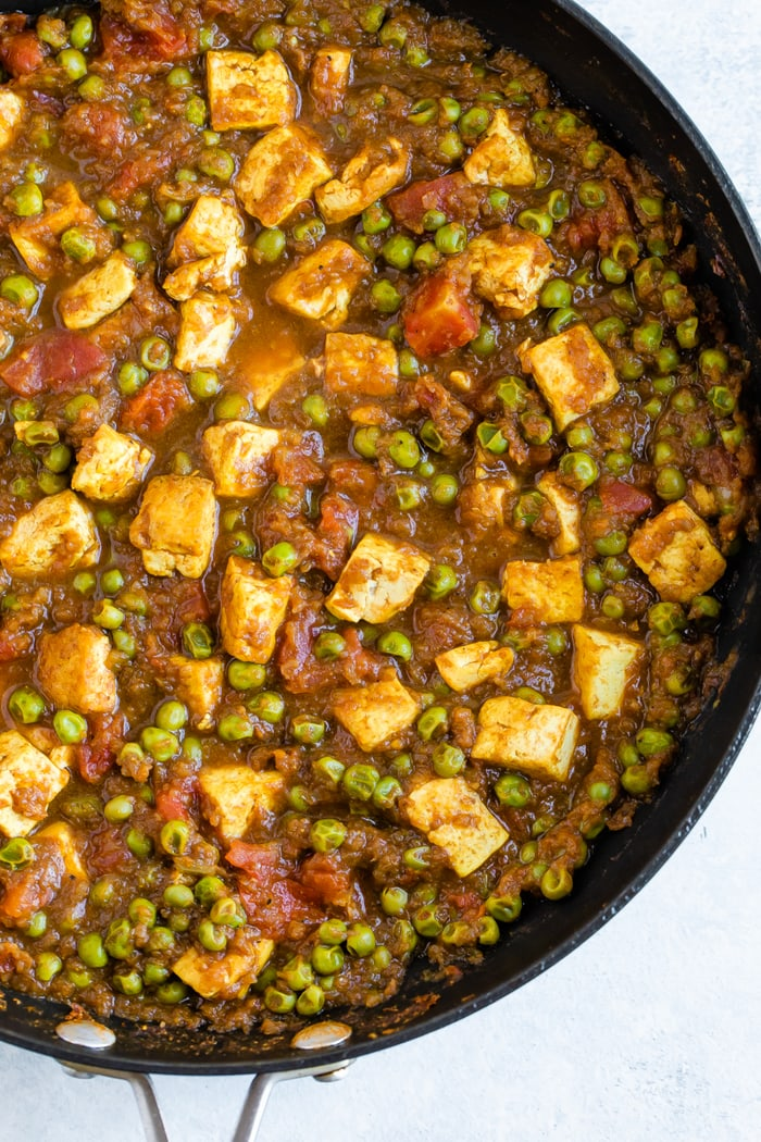 Pan full of mattar tofu-- tofu cooked in tomatoes and peas.