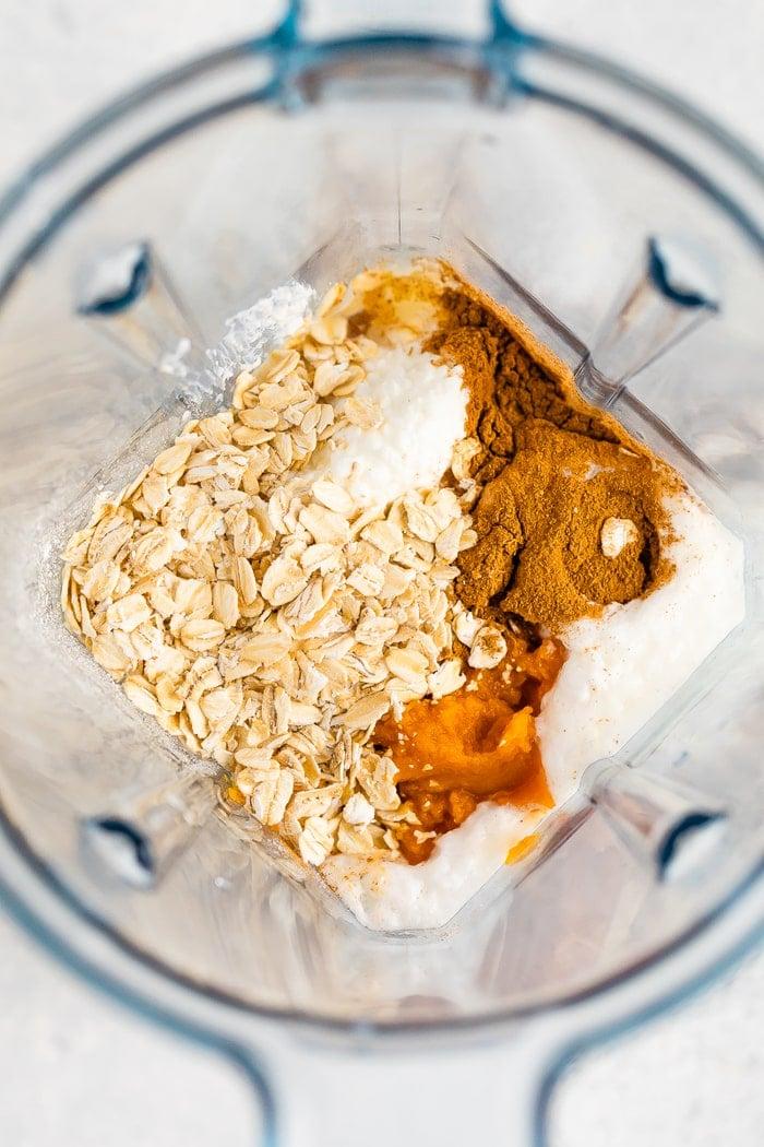 Blender with ingredients for pumpkin pancake batter.