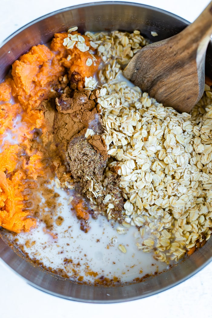 Mixing bowl with ingredients for sweet potato baked oatmeal.