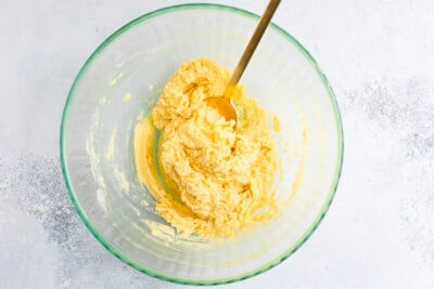 Coconut flour sugar cookies dough in a bowl with a gold spoon.