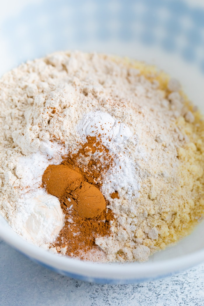 Mixing bowl with dry ingredients to make almond flour and oat flour snickerdoodles.