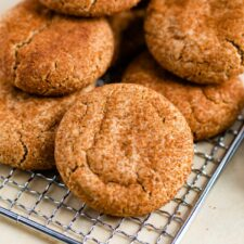 Healthy snickerdoodle cookies on a gold cookie tray.