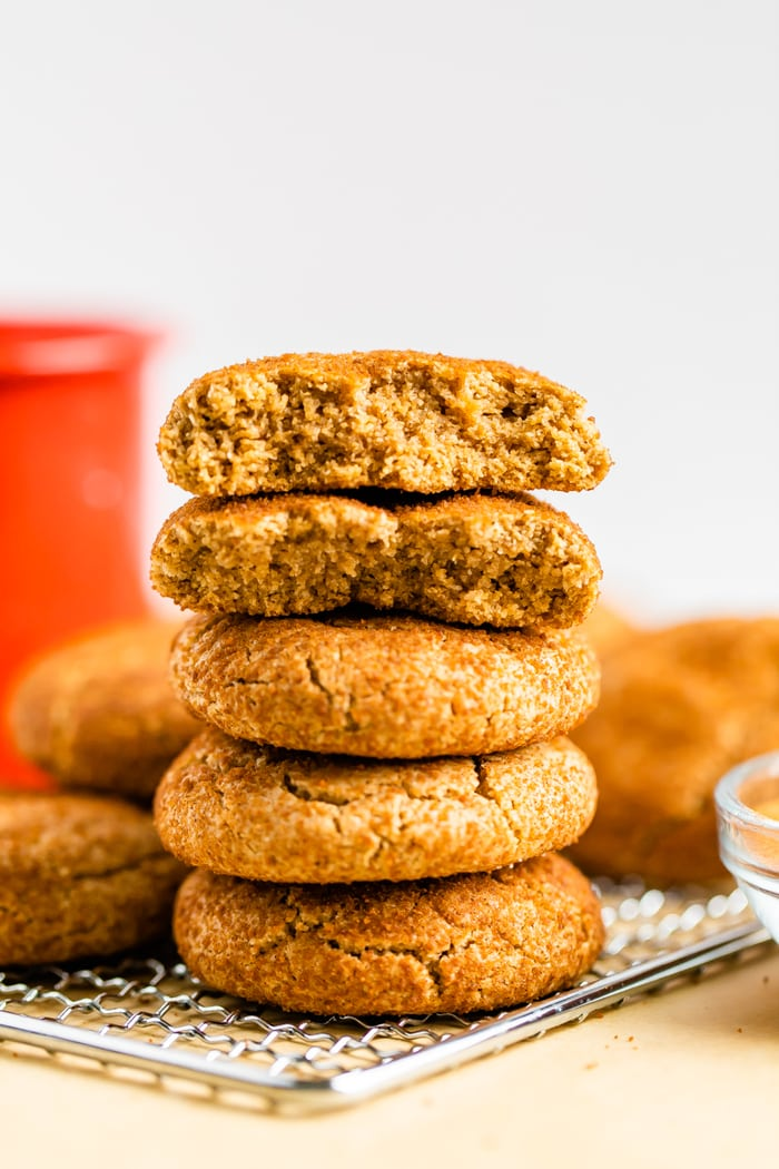 Stack of fluffy snickerdoodle cookies. The top two cookies are split in half.