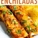 Two baked chicken enchiladas on a plate.