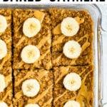 Square baking dish with peanut butter banana baked oatmeal with a slice taken out of it.