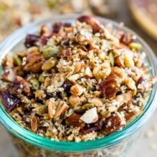 Glass jar with hemp granola made with nuts and seeds.