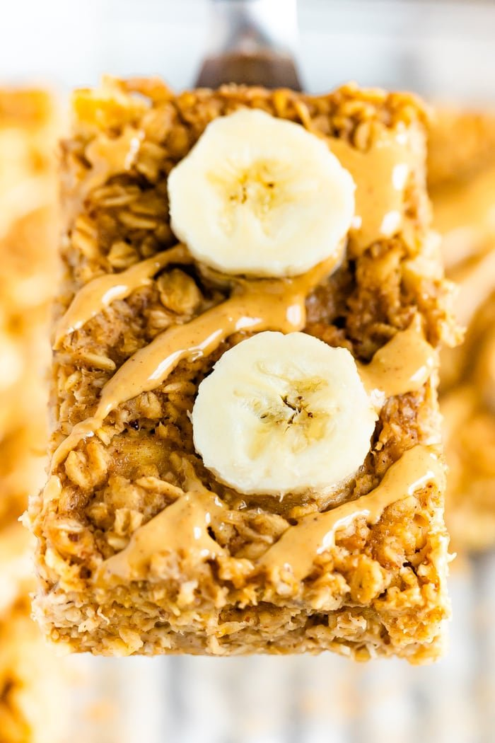 Spatula lifting a slice of peanut butter banana baked oatmeal.