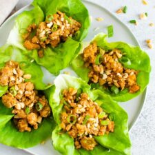 Four leaves of lettuce with a ground chicken Asian filling.