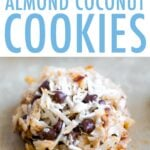 Close up of a almond coconut chocolate chip cookie on a cookie sheet.