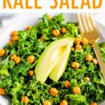 Kale salad topped with chickpeas and avocado.