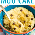 Chocolate Chip Mug Cake in a mug with a spoon scooping a bite.