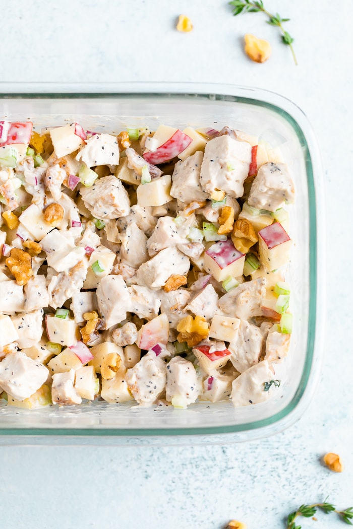 Rectangle glass container filled with grilled chicken waldorf salad.
