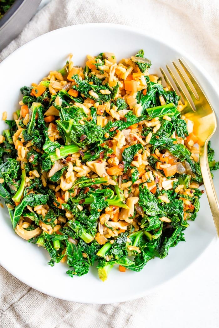 Bowl of sautéed kale, mushrooms and Spanish rice.