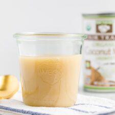 Glass jar of sweetened condensed coconut milk.