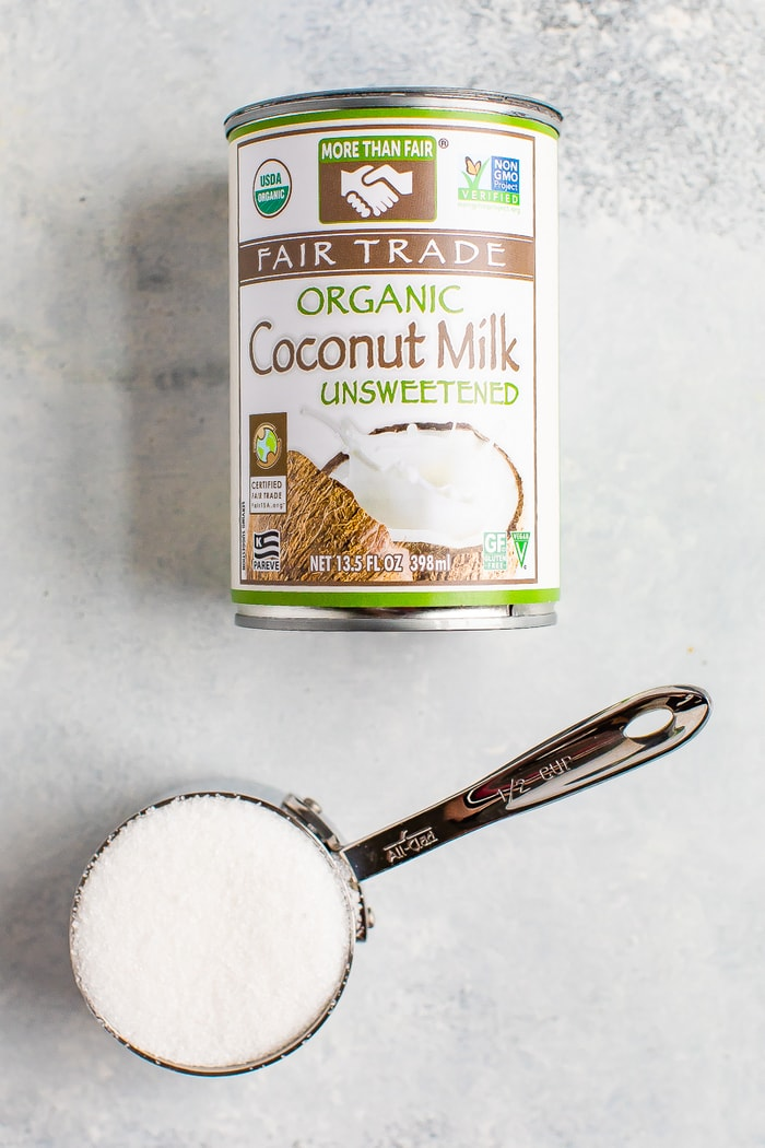 Can of coconut milk and a measuring cup of sugar.