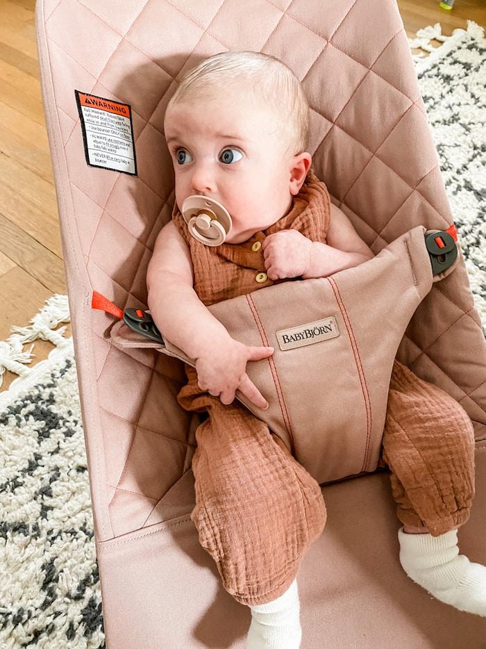 Baby girl in Old Rose Baby Bjorn Bouncer