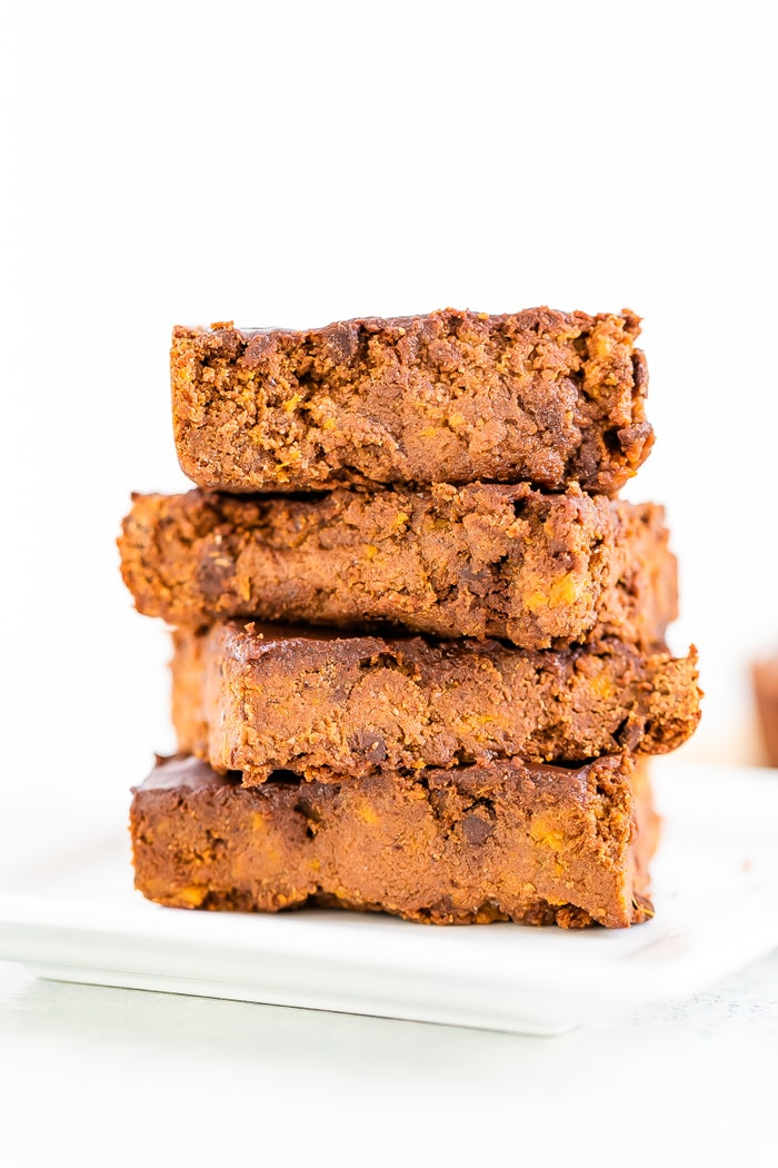 Stack of four sweet potato brownies.