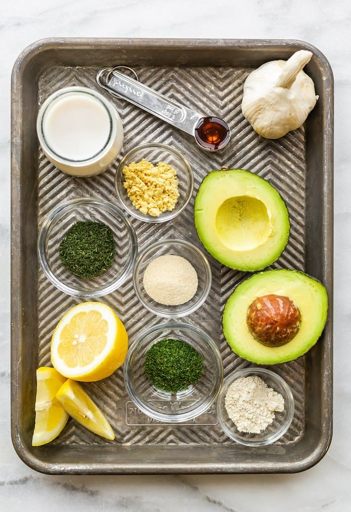 Baking tray with ingredients for avocado ranch dressing laid out.