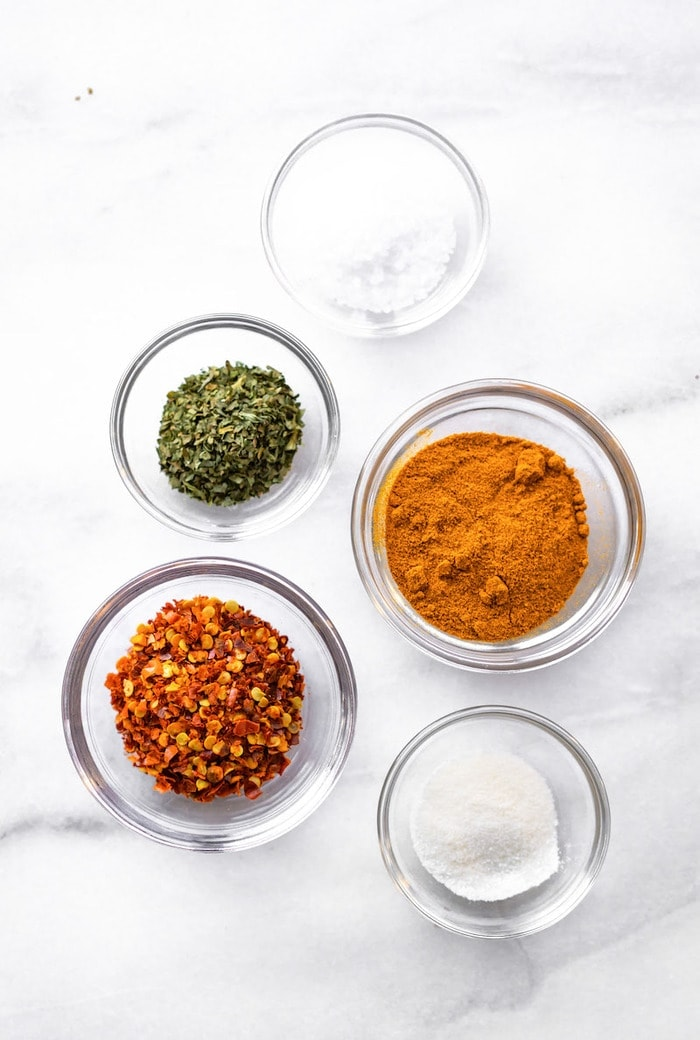 Ingredients measured out in glass bowls.