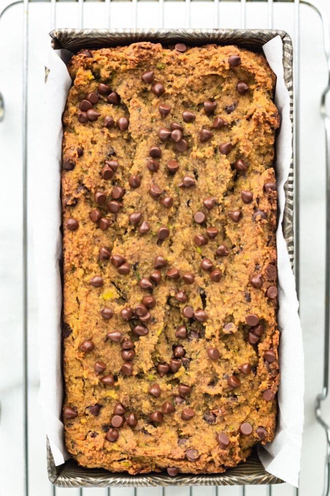 Loaf pan of chocolate chip zucchini bread.