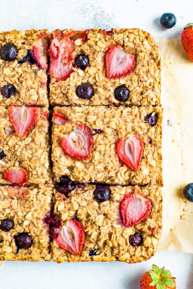 Berry oatmeal bars cut into squares.