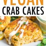Close up photo of a vegan crab cake drizzled with a creamy dressing and fresh parsley.